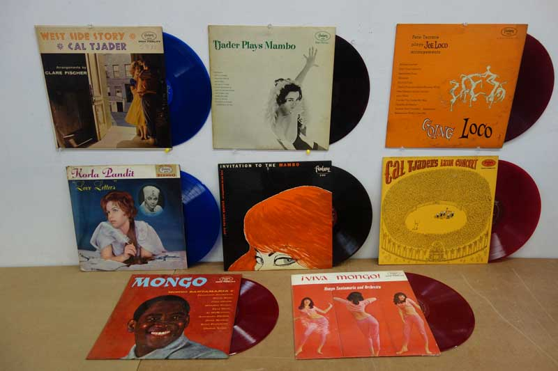 Eight Mambo LPs on colored vinyl (the dark ones in the middle are actually very dark red).
